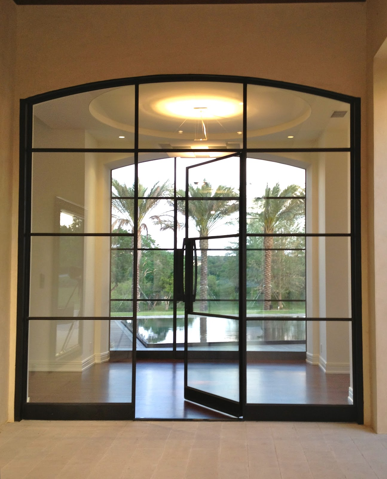 Steel doors with sidelites and transom portella for Room door frame