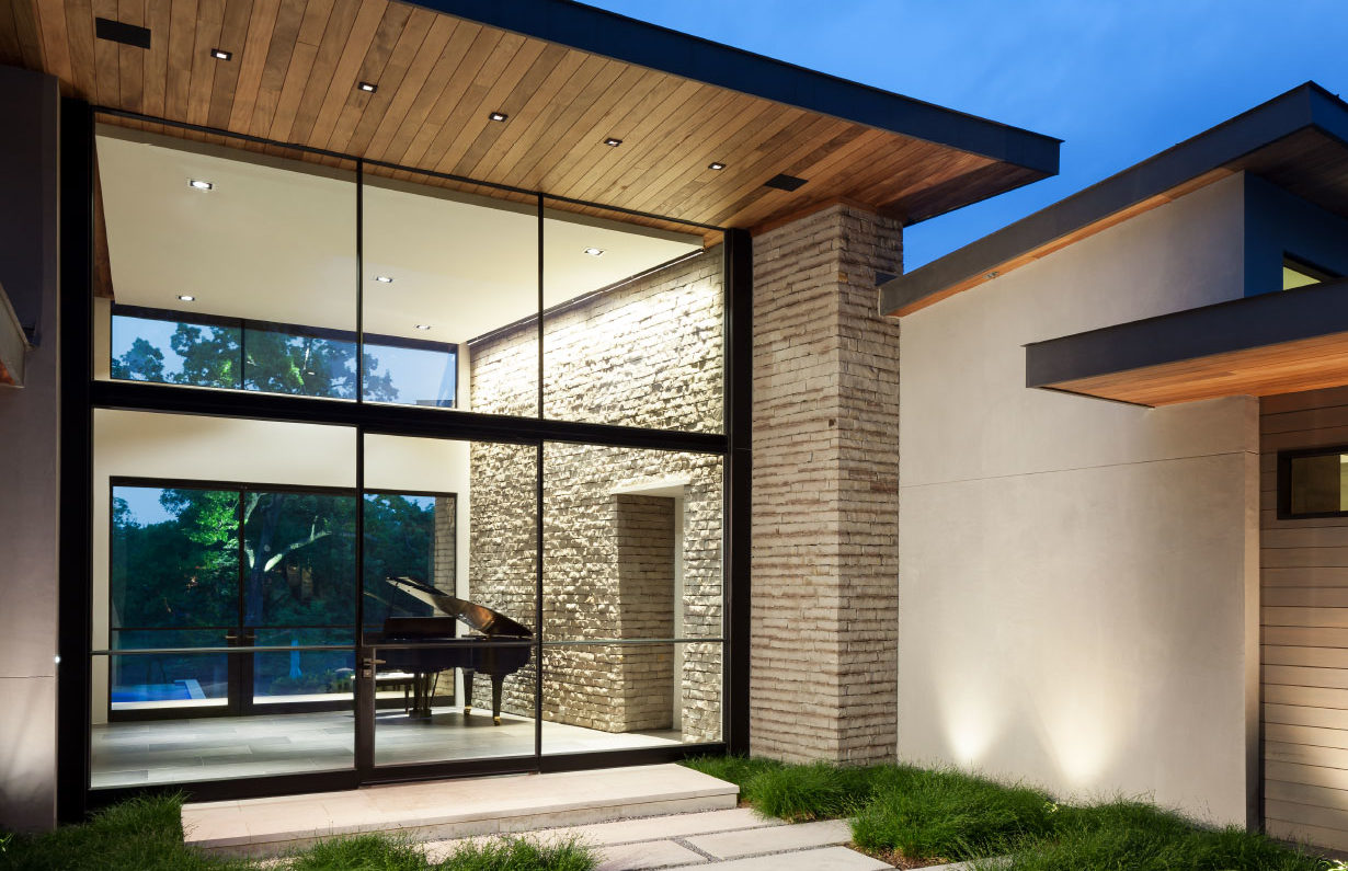 Modern house with piano and Portella windows.