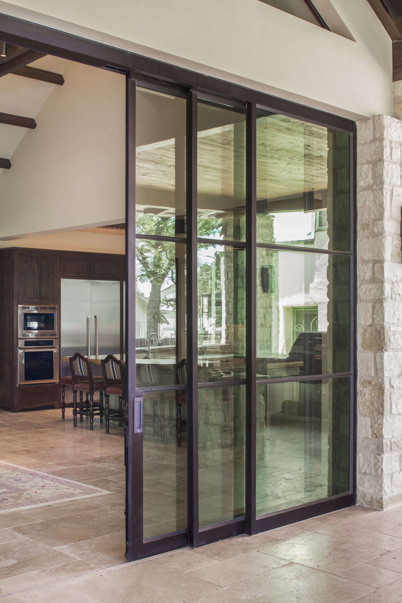 Artisan pocket sliding doors portella steel doors and for Exterior multi track sliding doors